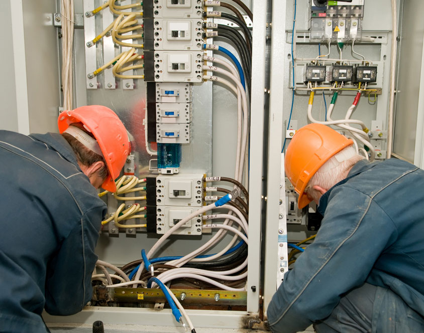 Two electricians checking the wirings