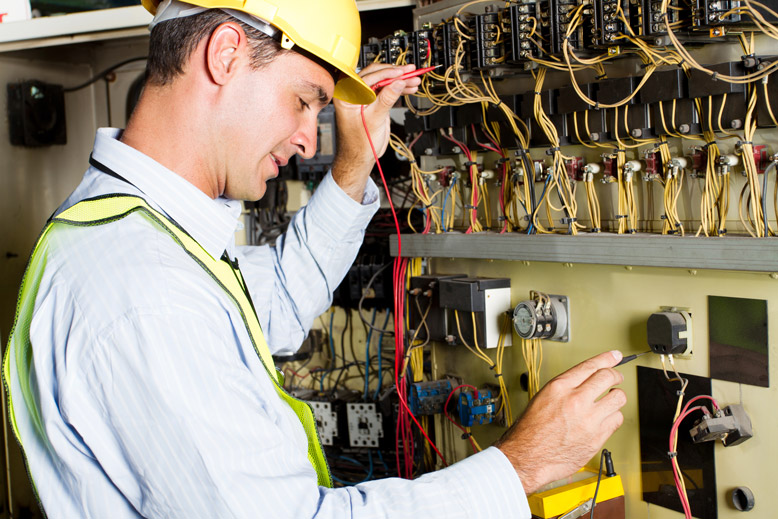 Electrician checking the electrical flow using the tester